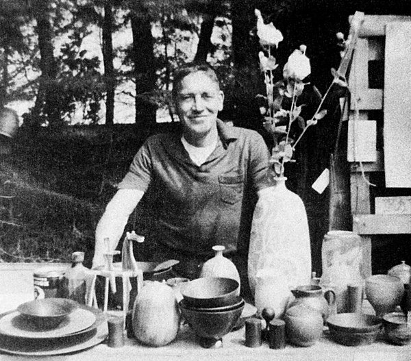 Bill Zacha, with ceramics and Matilija poppies, at the 1966 Mendocino Art Center Fair.