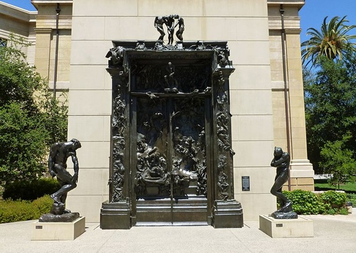 Rodin's Gates of Hell, flanked by the figures of Adam and Eve, at the B. Gerald Cantor Rodin Sculpture Garden, Cantor Arts Center, Stanford University, Palo Alto, California. The Rodin Sculpture Garden is open at all hours, with lighting for nighttime viewing.