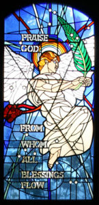 Praise God from Whom all blessings flow, one of the stained glass windows designed by Charles Marchant Stevenson for St. Michael and All Angels Episcopal Church, 201 E. Fir Street, Fort Bragg California.