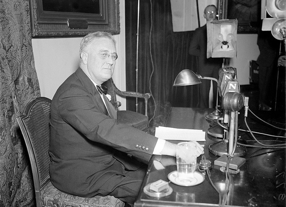 President Franklin Delano Roosevelt (FDR) just before his April 28, 1935 Fireside Chat, his weekly radio talk with the American people. The President is preparing to announce that he has just signed the bills creating Social Security and the WPA, the most important of his administration's New Deal programs to pull the United States out of the Great Depression. Photo from the Harris & Ewing collection at the Library of Congress.