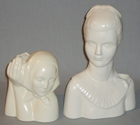 Peasant Head by Dorr Bothwell to the left of Woman with Collar, probably designed by Jean Lawyer, both shapes were produced in Gladding, McBean's Catalina Art Ware line, (Cream glaze).