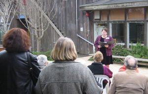 Rev. Marianne McGee dedicates Fran Moyer's memorial tile, Mendocino Art Center Courtyard (2007). Photo: CG Blick