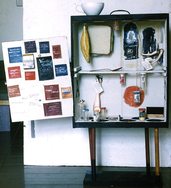 "The Alchemist's Valise by Fran Moyer (front, door open), A cabinet assemblage of polychrome wood and found objects (64""), 1963."