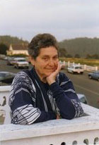 Hilda Pertha on her deck overlooking the Mendocino Headlands, upstairs from Zacha's Bay Window Gallery.