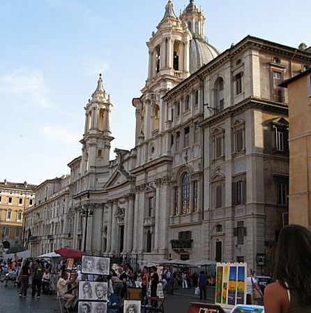 The Chiesa di Sant'Angese in Agone stands on the western side of Piazza Navona. In Bill Zacha's Roma (1952), one of the church's twin bell towers (Francesco Borromini, c. 1652) is visible at the top right.