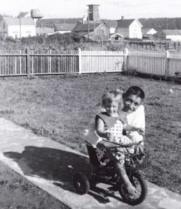 Lucia Zacha, with her father, in the front yard of the Albert Brown House (1959).