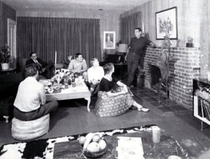 Inside the Albert Brown House, Bill and Jennie Zacha with friends (1959). Fran Moyer (left) , Jennie (center), Bill (standing), One of Bill's watercolors of the Piazza del Popolo over the fireplace, and one of Fran Moyer's welded steel sculptures to the side.