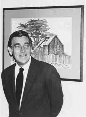 Bill Zacha, with his watercolor, August Evening, Mendocino (1972).